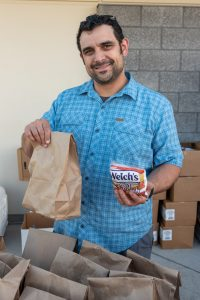 J.D. Leonetti from Prohibition Gastropub hands out food to needy kids